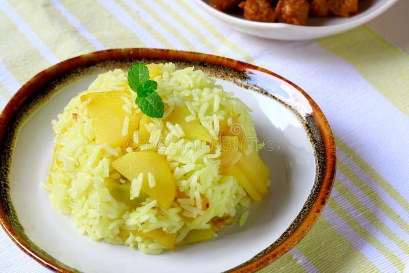 Potato Fried Rice. A vegetarian dish, fried rice with potato and turmeric stock photography