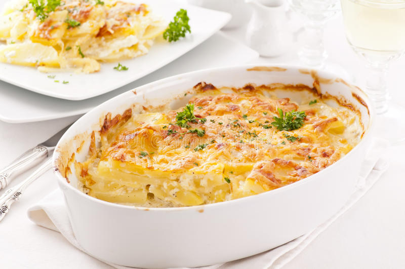 Potato gratin. With cream and cheese stock images