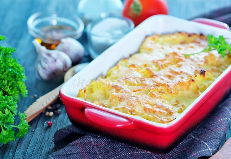Potato gratin. With cheese on a table stock photos