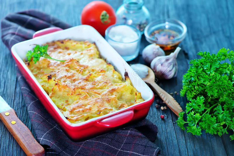 Potato gratin. With cheese on a table stock image