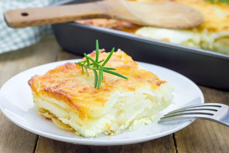 Potato gratin. On a white plate royalty free stock photos