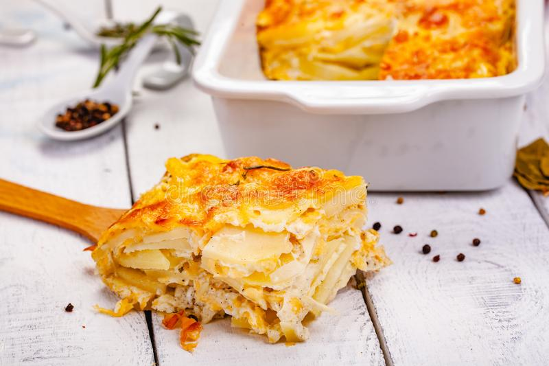 Potato gratin on wooden rustic table. Close up royalty free stock photo