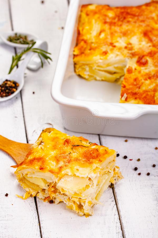 Potato gratin on wooden rustic table. Close up stock images