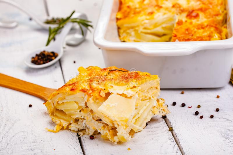 Potato gratin on wooden rustic table. Close up royalty free stock photos
