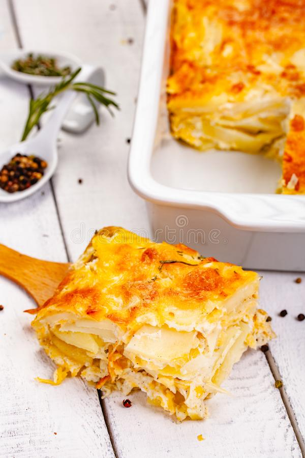 Potato gratin on wooden rustic table. Close up stock image
