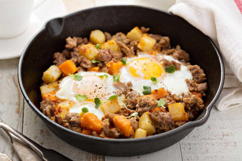 Potato hash with eggs royalty free stock images