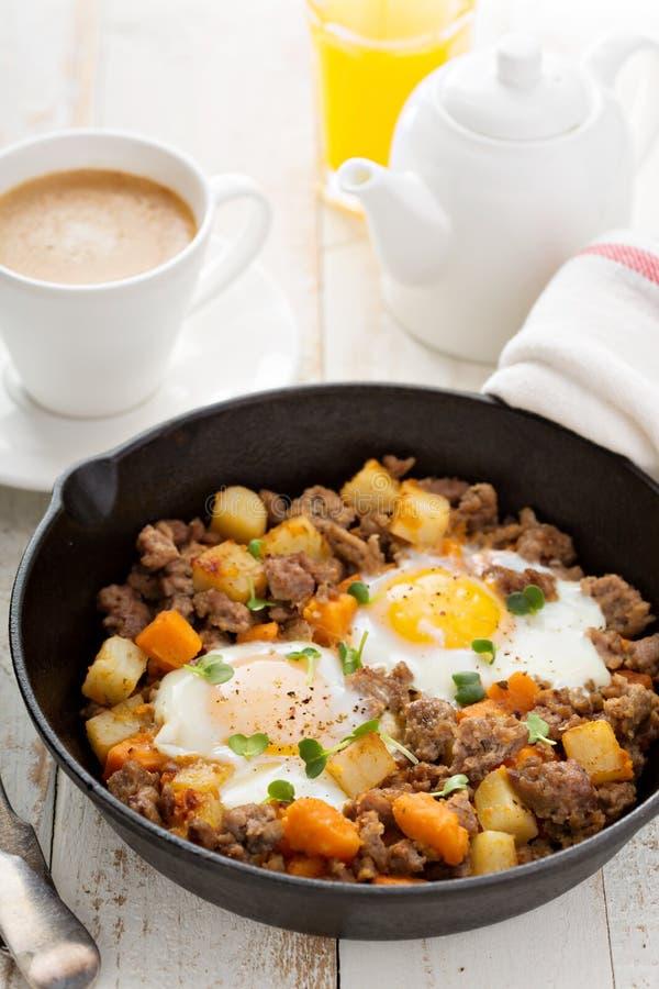 Potato hash with eggs royalty free stock photos