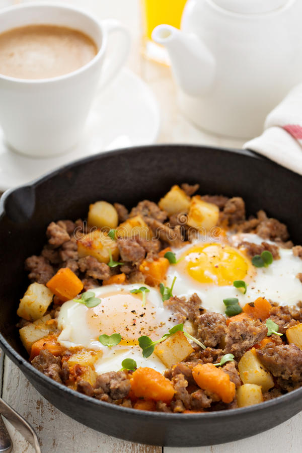 Potato hash with eggs royalty free stock image