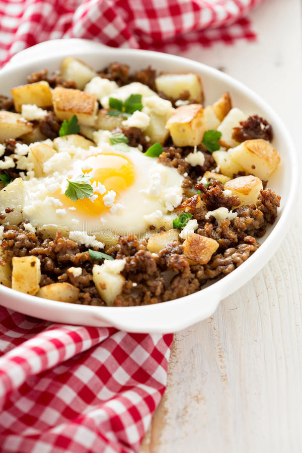 Potato hash with sausage and fried egg royalty free stock photo
