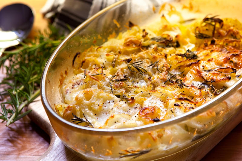 Potato and Onion Gratin. With rosemary, in warm light stock photos