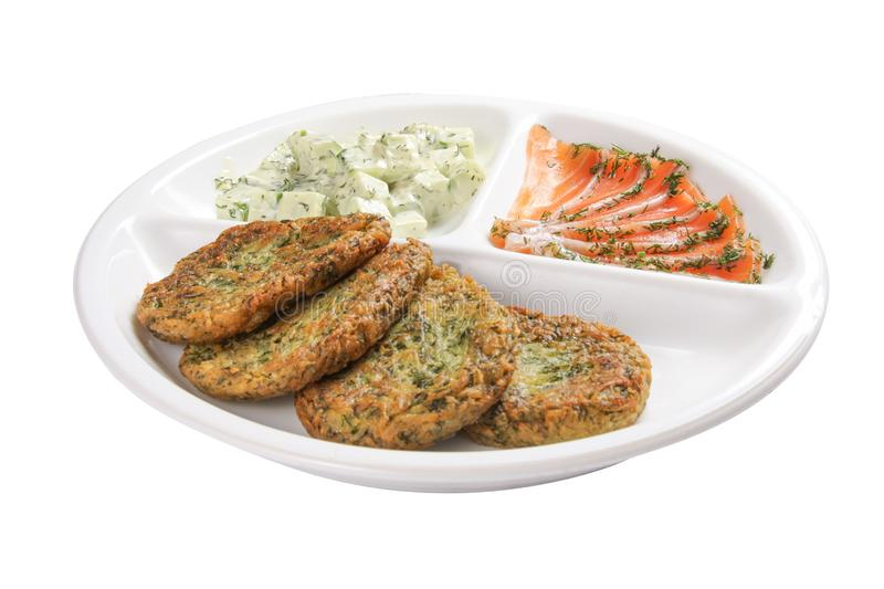 Potato pancakes with salted salmon. On a white background stock photography