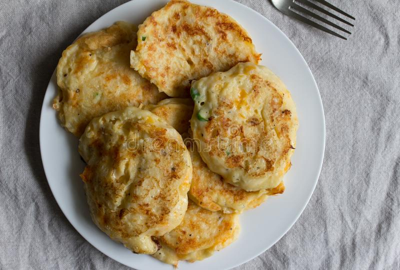 Potato pancakes on white plate - Top view stock photography