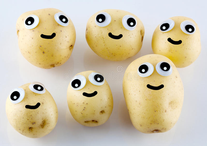 Potato people with eyes and smiles royalty free stock photos