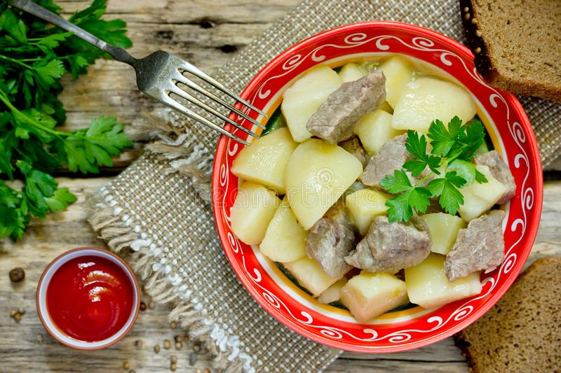 Potato and pork meat stew in bowl royalty free stock image