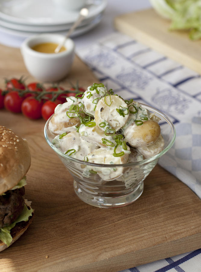 Potato salad in glass bowl stock image