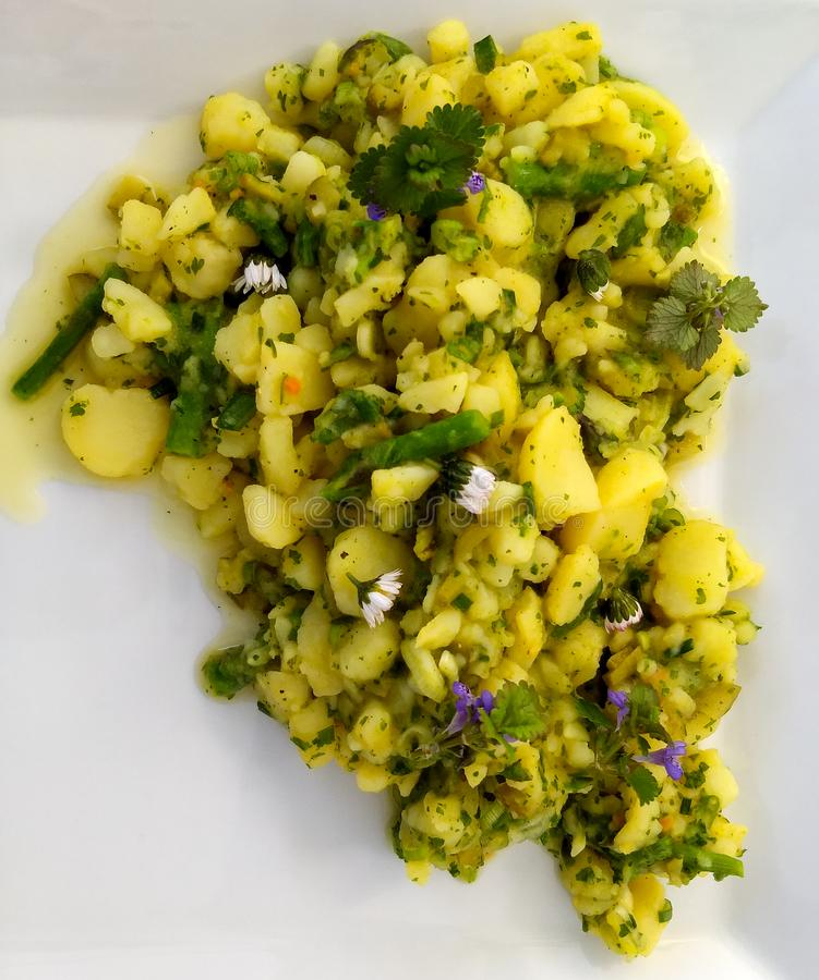 Potato salad on a white plate royalty free stock photo