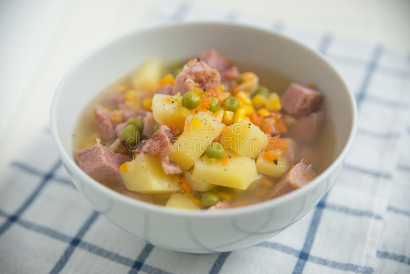 Potato Soup with ham, peas stock photos