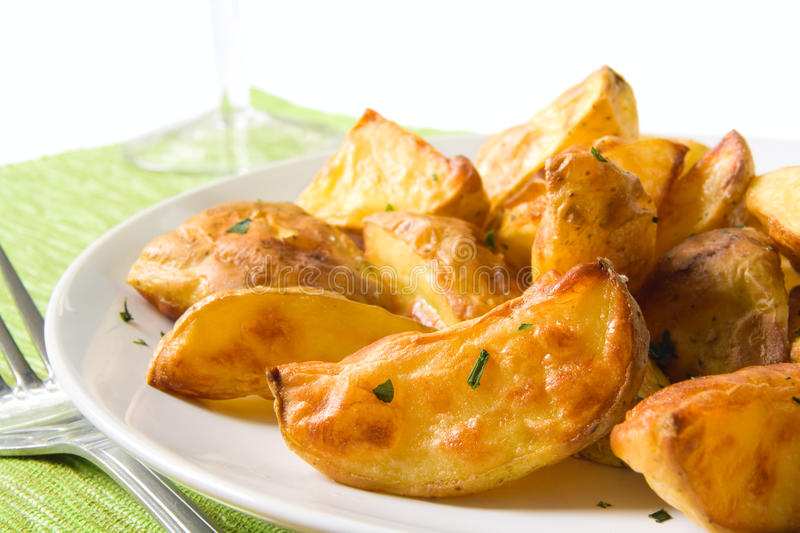 Potato wedges. Tasty homemade potato wedges on a plate royalty free stock photo