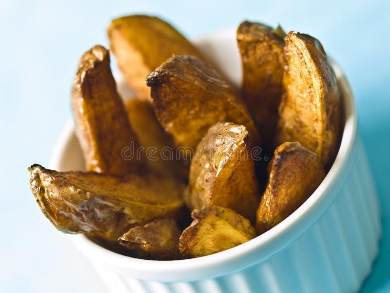 Potato wedges. Deep fried potato wedges close up stock photo