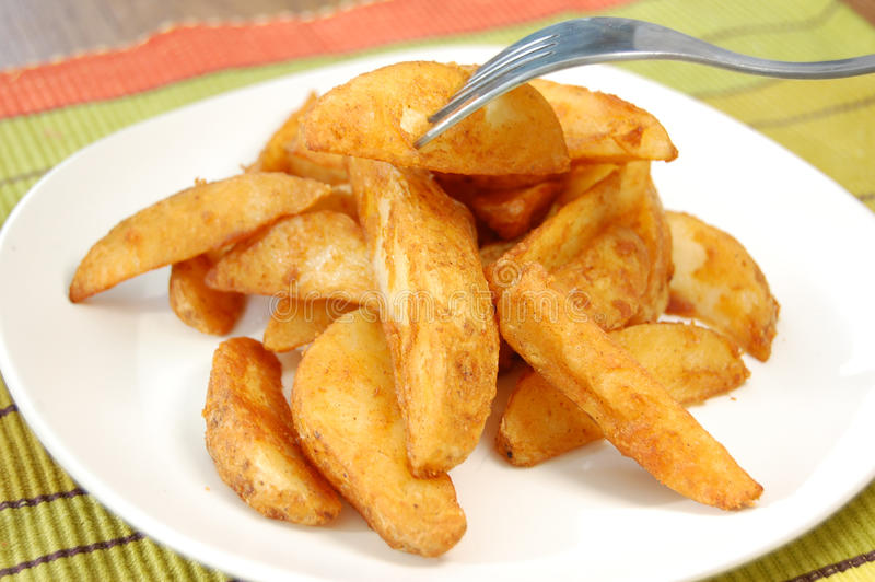 Potato wedges. Plate of delicious potato wedges stock images