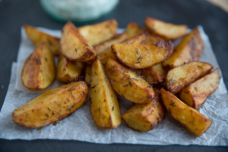 Potato Wedges. Home made Potato Wedges on a plate stock photo