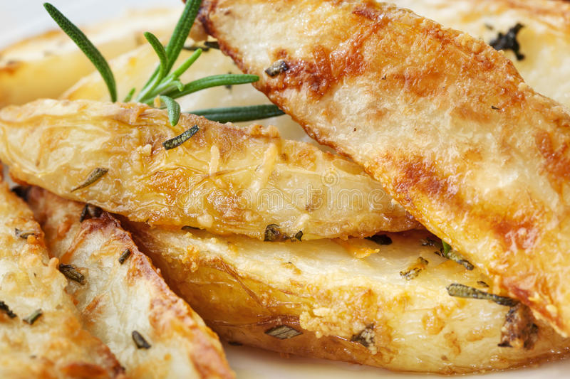 Potato Wedges with Parmesan and Herbs.  royalty free stock image