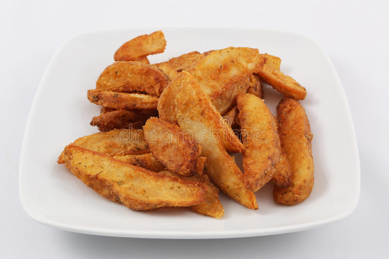 Potato wedges. For side order with pizza royalty free stock photo