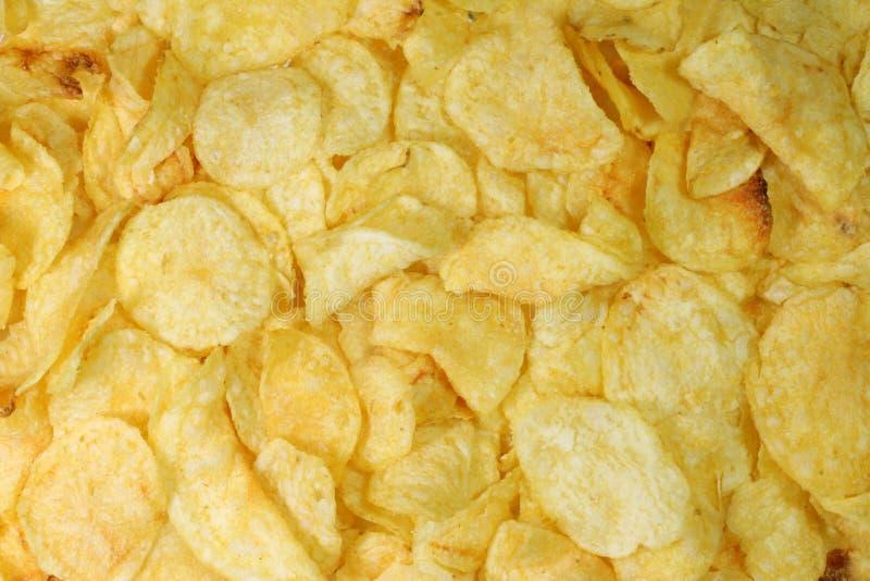 Potatoe lasca o fundo fotografia de stock royalty free