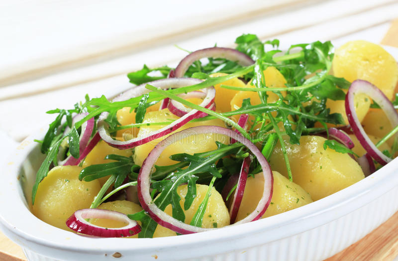 Download Potatoes With Arugula And Onion Stock Photo - Image: 25227930