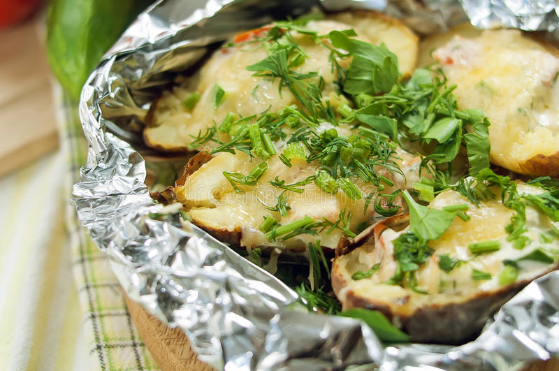 Potatoes baked in foil stock image