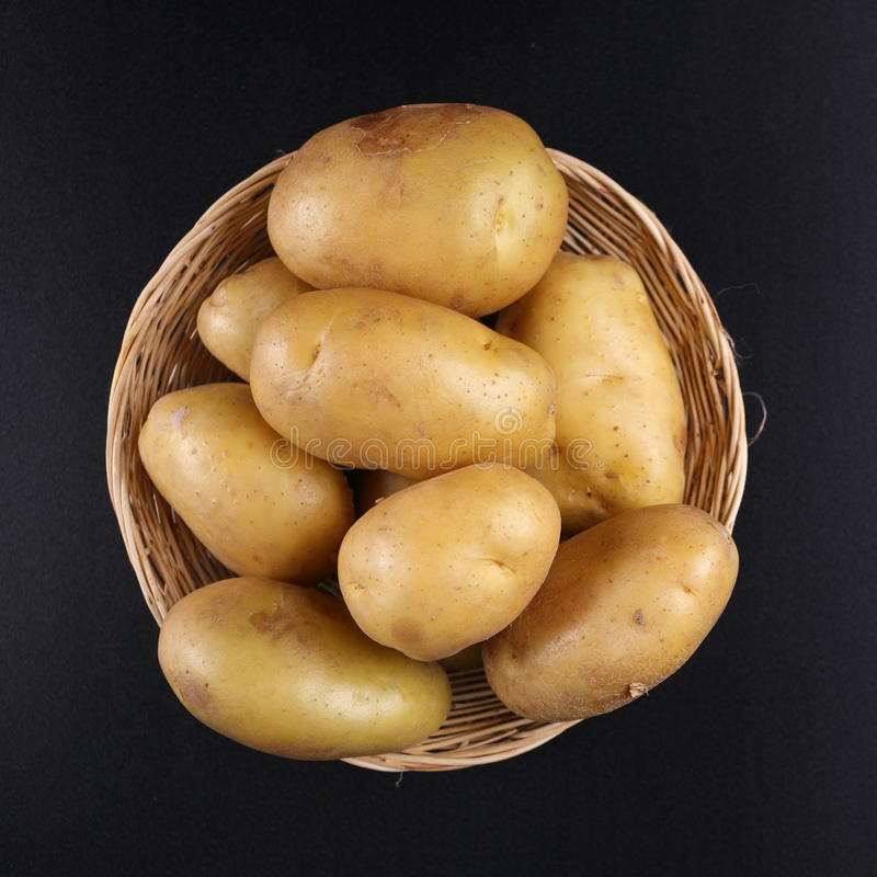 Potatoes on basket stock photo