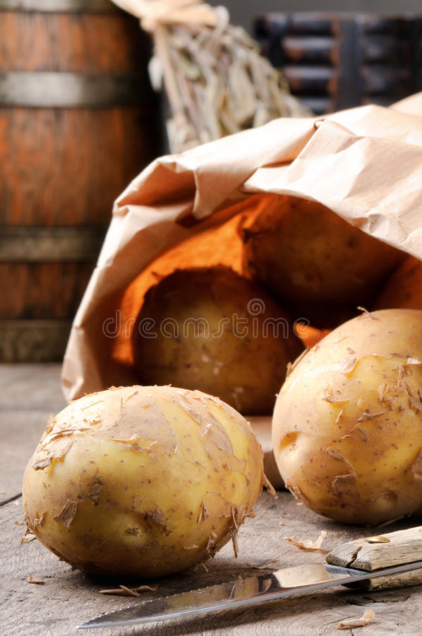 Potatoes in a brown paper bag stock photo