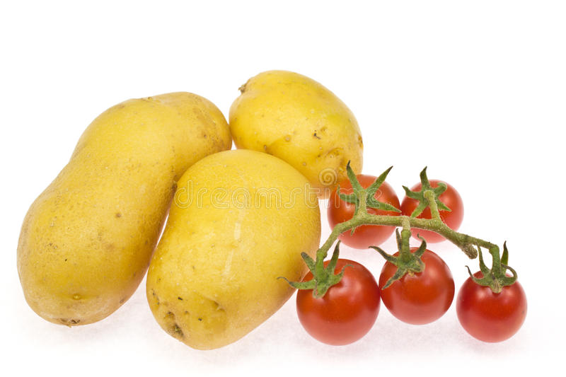 Potatoes And Cherry Tomatoes Stock Photography