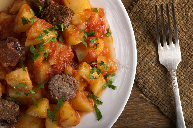 Potatoes with chorizo cooked Rioja style. A traditional Spanish recipe stock images