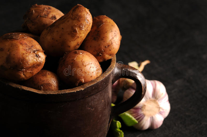 Potatoes In A Clay Pot Stock Photography