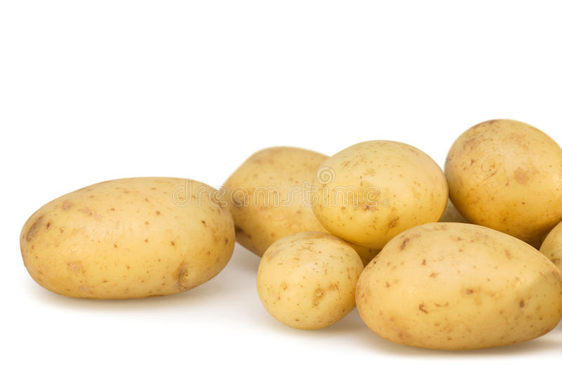 Download Potatoes on white isolated stock photo. Image of horizontal - 14547360