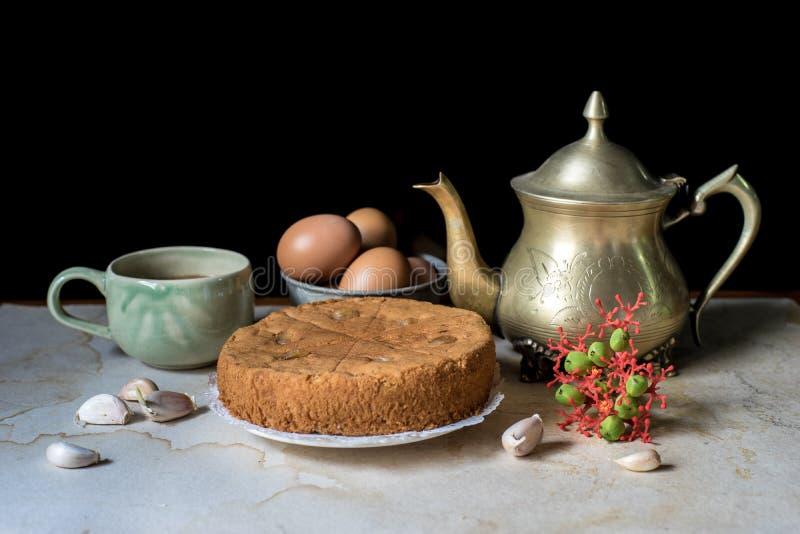 Pote antiguo del té imagenes de archivo