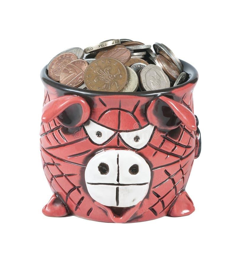 Pote de cerámica por completo de las monedas de libras británicas imágenes de archivo libres de regalías