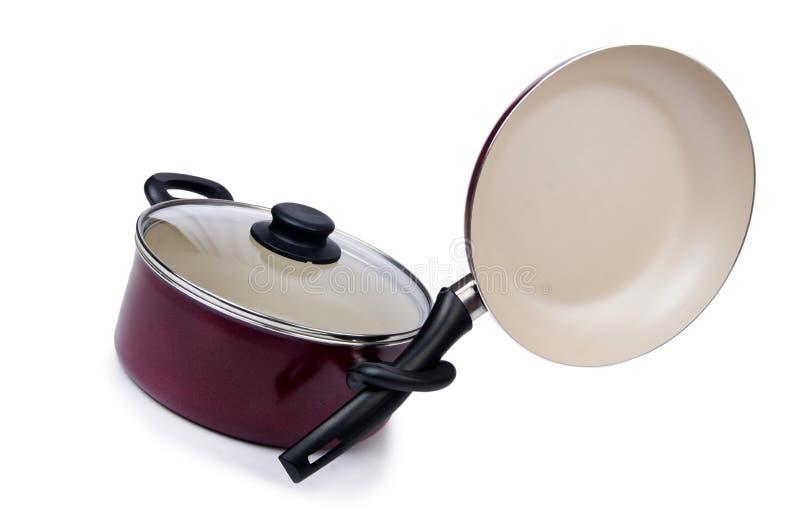 Pote de la cacerola de los utensilios de la cocina aislado fotos de archivo
