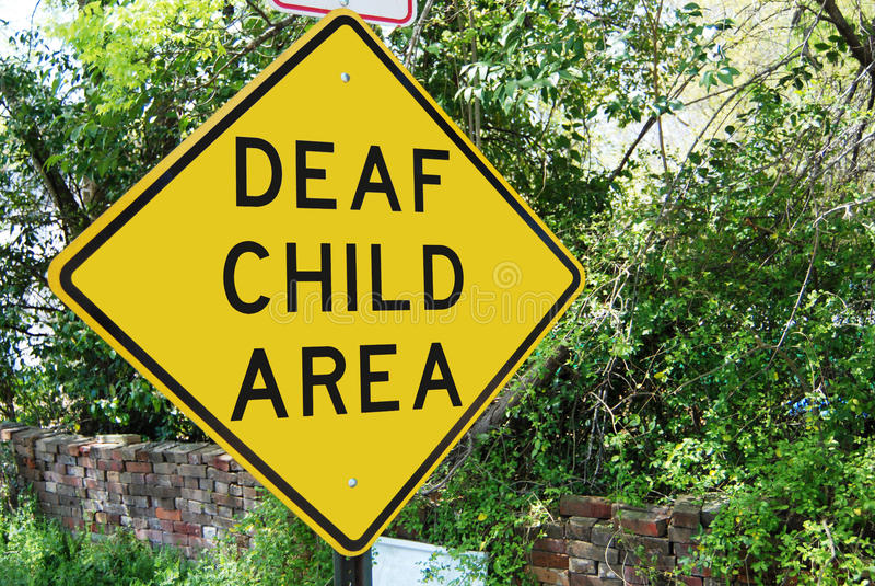 Poteau de signalisation sourd d'enfant images libres de droits