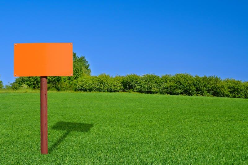 Poteau de signe orange photos stock