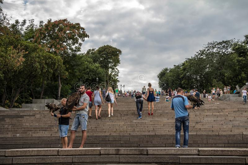 Potemkin stairs with people posing with eagles on them. The Odessa stairs, pictured in the famous Soviet movie Potemkin royalty free stock photos