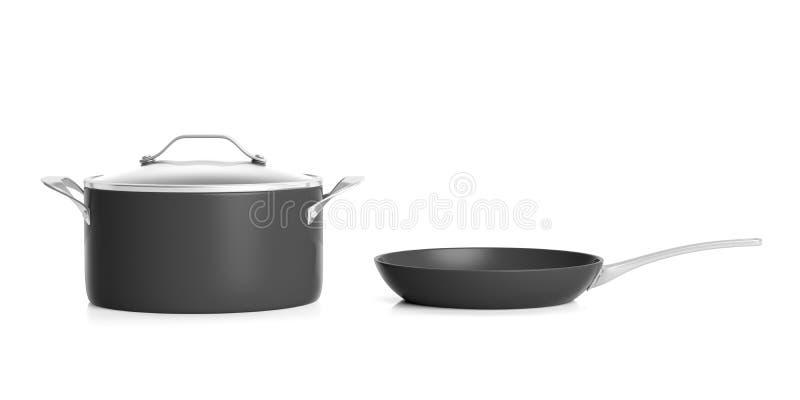 Potenciômetro preto e frigideira de cozimento de aço inoxidável isolados no fundo branco ilustração 3D ilustração royalty free