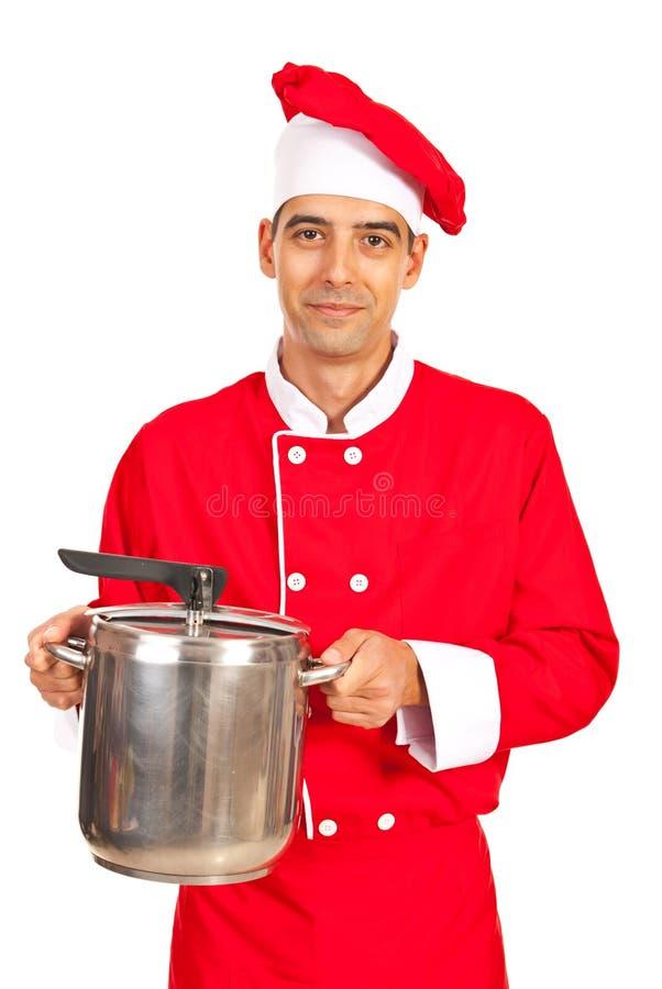 Potenciômetro guardando masculino do inox do cozinheiro chefe fotografia de stock