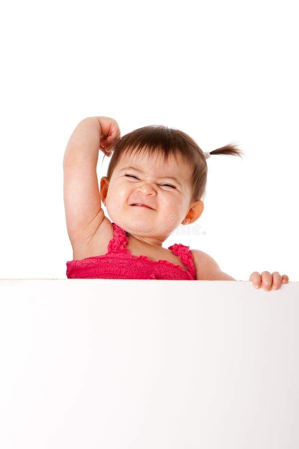 Potencia del bebé con la tarjeta blanca imágenes de archivo libres de regalías