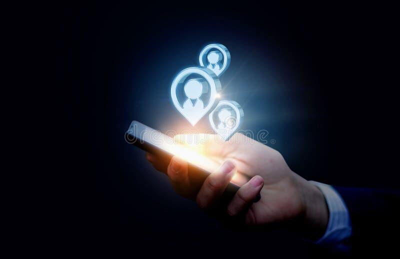 Potentiella kunder i mobiltelefonen fotografering för bildbyråer