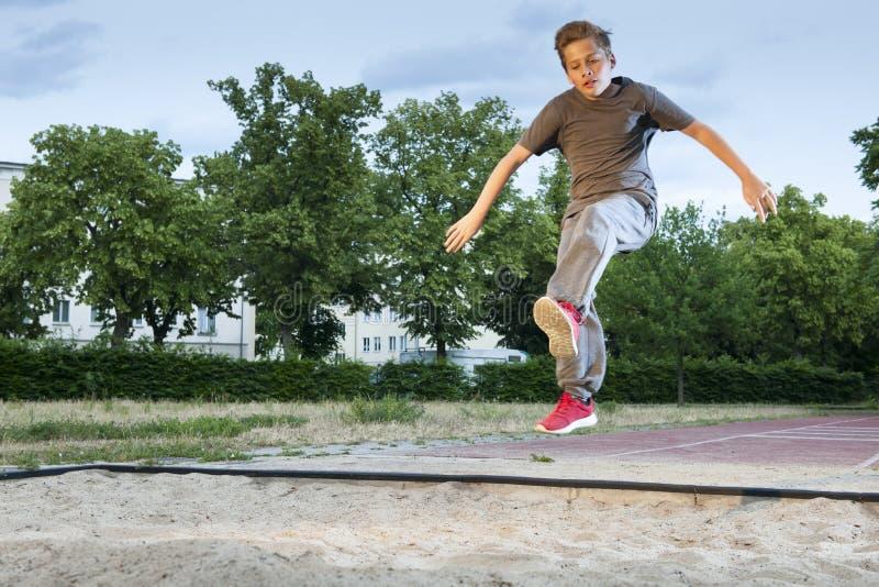 Potere per il salto in lungo fotografia stock libera da diritti