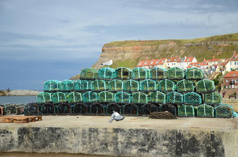 Potes de langosta de Fishermans encendido en el lado del muelle foto de archivo libre de regalías