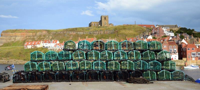 Potes de langosta de Fishermans encendido en el lado del muelle imágenes de archivo libres de regalías