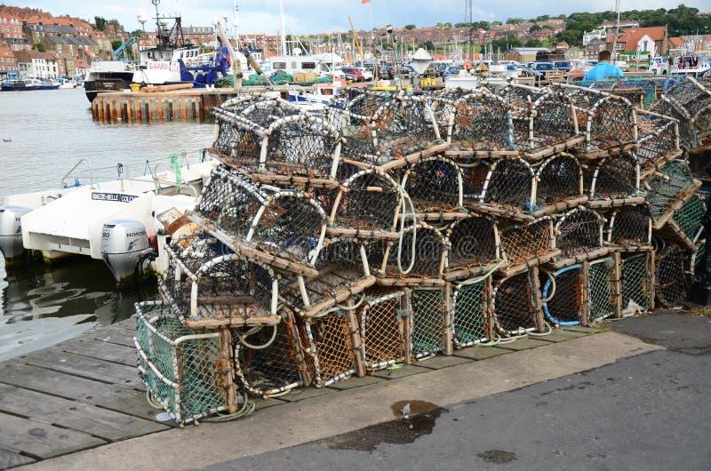 Potes de langosta de Fishermans encendido en el lado del muelle imagen de archivo libre de regalías